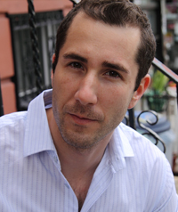 man in striped button down with short brown hair