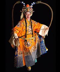 A person mid-dance in traditional Chinese costume.