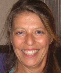 A woman smiles at the camera