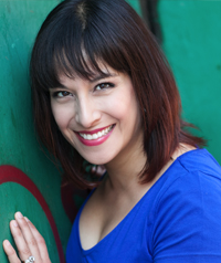 A woman in blue poses for the camera.