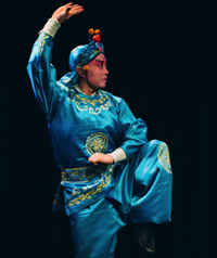 A person mid-dance is wearing traditional Chinese costume.