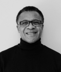 Man with glasses and black turtleneck