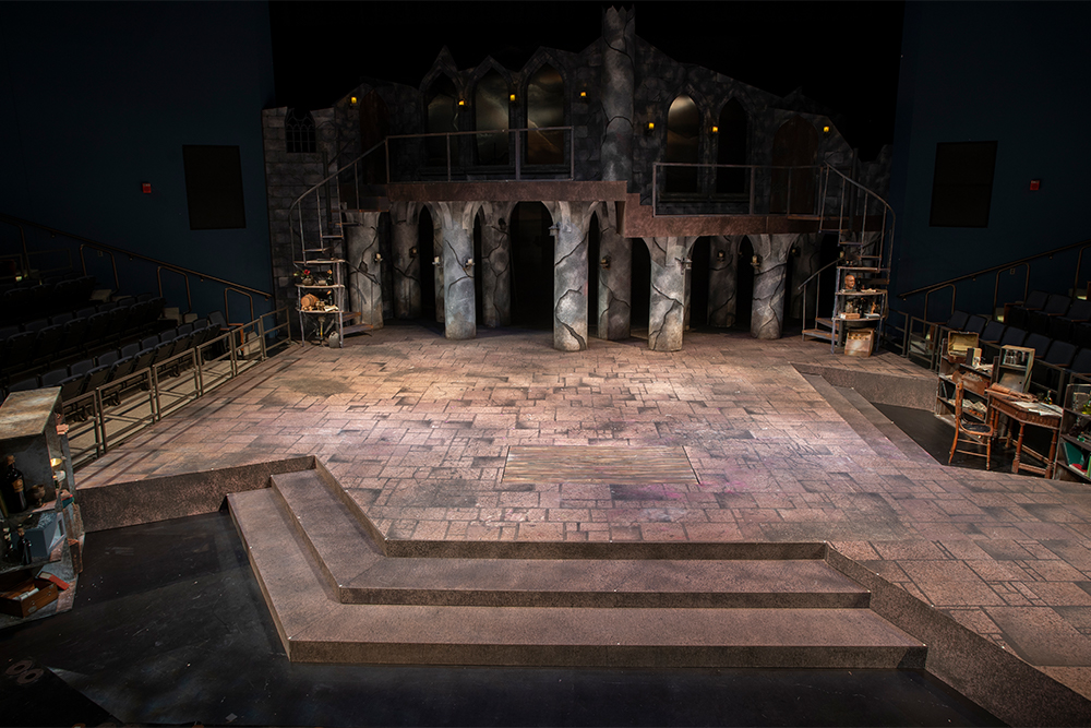 A photo of a multi-level gothic set on a thrust stage