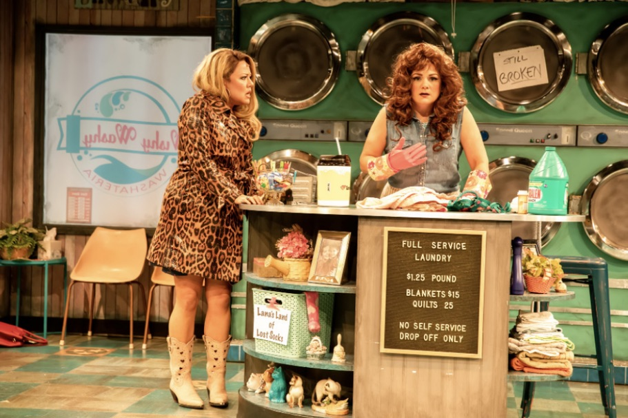 two woman in a play talking to one another